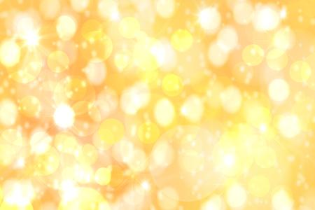 Feestelijke achtergronden. Abstracte feestelijke gouden gele bokeh achtergrondstructuur met intreepupil lichten. Kerstverlichting, wazige lichten, glitter schittering. Stockfoto