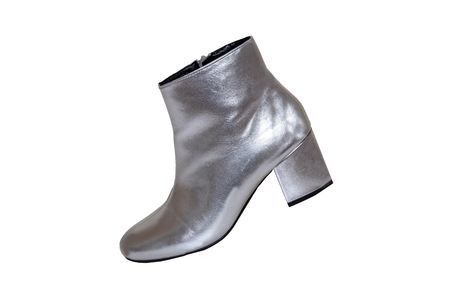 Womens boots and shoes. A pair female silver boots isolated on a white background. Leather shoe fashion new collection 2019.