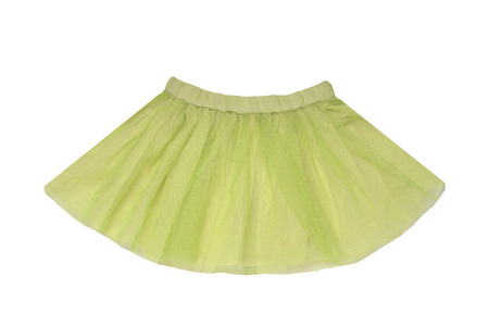 Girls clothes. Festive beautiful green glistening little girl short summer skirt isolated on a white background. Ballerina kids clothes. Banco de Imagens