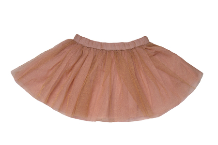 Girls clothes. Festive beautiful brown glistening little girl short summer skirt isolated on a white background. Ballerina kids clothes. Banco de Imagens