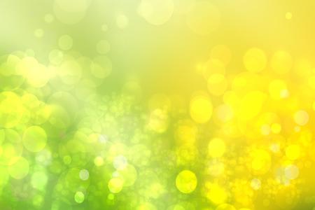 Abstraktes grünes Licht und gelber bunter Sommerbokehhintergrund.