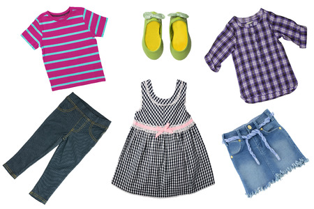 Summer fashion. Collage set of baby child girl clothes isolated on a white background. T-shirts, skirts, shoes or sneaker and jeans skirt.