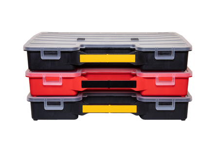 Equipment of craftsman. Three professional plastic storage boxes for screws, bolts, dowels and some other components isolated on a white background. Handyman accessories.