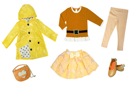 Summer fashion. Collage set of baby child girl clothes isolated on a white background. T-shirts, skirts, shoes or sneaker and rain jacket.