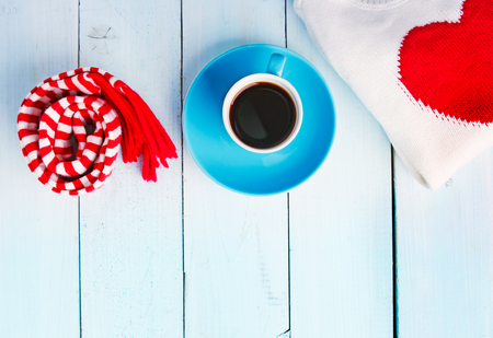 Christmas decoration concept empty copy space. Valentine's card.Coffee cup on blue wooden table.