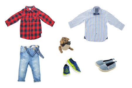 Set of spring and summer fashion for boys. Beautiful jeans, shirts and shoes. Isolated on white.