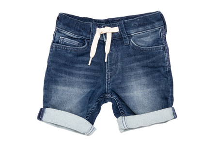 Jeans shorts isolated. Trendy stylish short jeans pants with white ribbon for child boy isolated on a white background. Fashionable denim short pants.