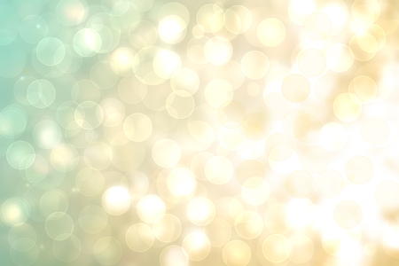 A festive abstract golden turquoise gradient background texture with glitter defocused sparkle bokeh circles. Card concept for Happy New Year, party invitation, valentine or other holidays.