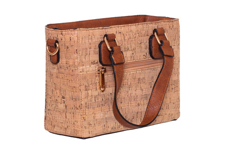 41a7de97a Hand bag isolated. Fashionable brown female luxury women bag made from oak  cork isolated on