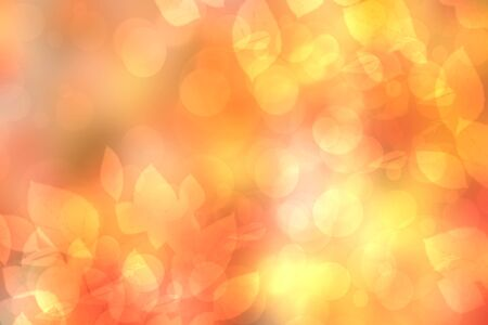 Abstract festive blur bright gradient orange yellow pastel background texture with glowing circular bokeh lights and leaves for Mothers day, valentine or wedding card. Space for design. Card concept.