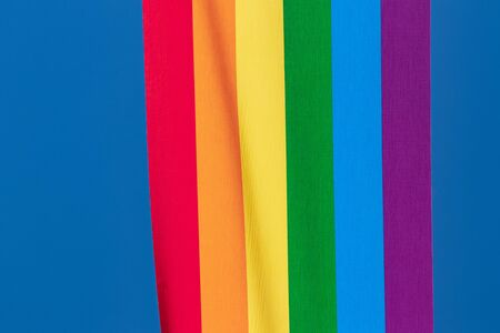 Rainbow backgrounds fabric. Closeup of rainbow linen canvas with colorful textured prallel vertical lines fabric macro. Outdoor LGBT background image.