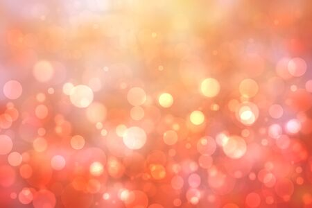 A festive abstract orange pink gradient background texture with glitter defocused sparkle bokeh circles. Card concept for Happy New Year, party invitation, valentine or other holidays.