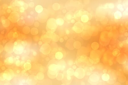A festive abstract golden yellow gradient background texture with glitter defocused sparkle bokeh circles. Card concept for Happy New Year, party invitation, valentine or other holidays.
