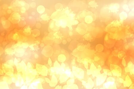 A festive abstract golden yellow gradient background texture with glitter defocused sparkle bokeh circles and leaves. Card concept for Happy New Year, party,  invitation, valentine or other holidays.