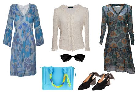 Collage woman clothes. Set of stylish and luxurious trendy women dresses, blouse, shoes. Blue handbag and accessories isolated on a white background. Latest fashion trends. Stock Photo