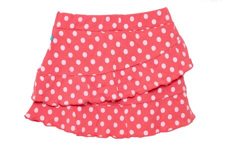 Summer skirt isolated. Closeup of a beautiful red little girl short polka dot skirt isolated on a white background. Children and kids fashion. Macro.