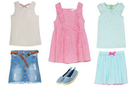 Collage set of little girl summer clothes isolated on a white background. The collection of jeans skirt and shoes, short summer skirt, two shirts and a red striped sleeveless dress. Little girl fashion.