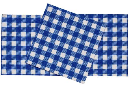 Closeup of a set of blue and white checkered kitchen cloth or napkin isolated on white background. Kitchen accessories. Macro.