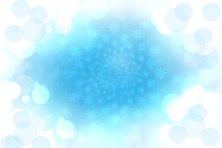 Abstract blurred festive light blue winter christmas or Happy New Year background with shiny blue and white bokeh lighted snowflakes and stars. Space for your design. Card concept.
