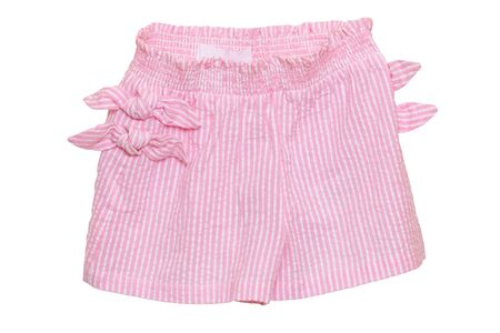 Summer shorts isolated. Closeup of a stylish fashionable striped pink shorts with ribbon bow isolated on a white background. Little girl fashion. Macro. Imagens