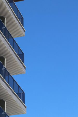 Angled  detail view of Panorama Balconies of a  modern mediterranean resort hotel at the seashore in Torremolinos against blue sky. Spain, Andalusia, Costa del Sol May 2019.
