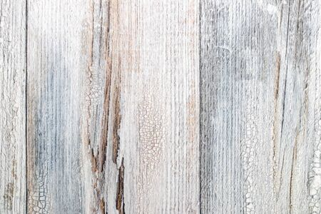 Gray brown wooden texture. Closeup of light gray rustic wooden immitation background. Beautiful backdrop with artificial wood grain. Macro.