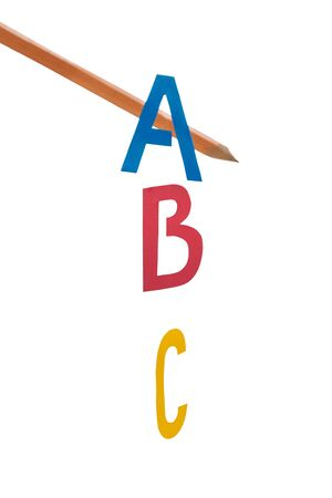 An A B C letters background. Close-up of ABC and of a pencil with focus on letters isolated on a white background. Back to school. Imagens