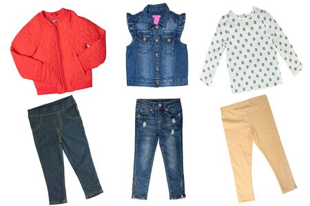Collage set of little girl spring clothes isolated on a white background. The collection of a jeans vest and two denim pants, a red down jacket, a shirt and a yellow trousers. Little girl autumn fashion.