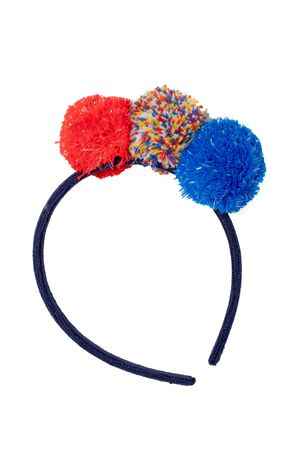 Clothes for children. Close-up of colored hairband with colorful fluffy fabric balls for the little girl isolated on a white background. Macro. Stockfoto