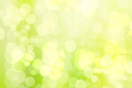 Abstract bright spring or summer landscape texture with natural green bokeh lights and yellow circular lights with sunshine. Beautiful Autumn or summer background with copy space.