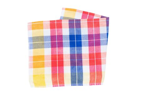 Closeup of a blue, white, red, yellow, and orange checkered napkin or tablecloth isolated on white background. Dishtowels are kitchen accessories. Imagens