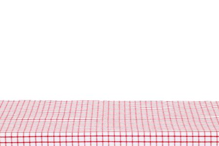 Empty table background. Empty wooden deck table covered with red white checkered tablecloth isolated on a white background. Space for your food and product display montage.