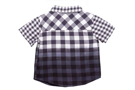 Checked shirts. Close-up of a gray white tartan or plaid shirt for boy isolated on a white background. Childrens summer fashion. Back side view. Imagens