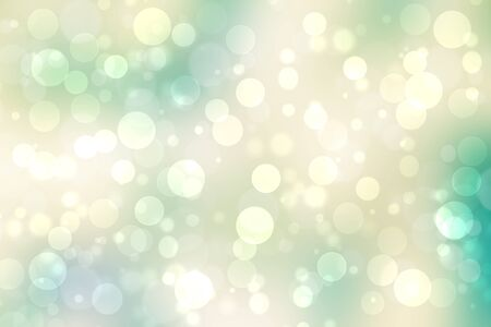 Abstract gradient turquoise light yellow turquoise shiny blurred background texture with circular bokeh lights. Beautiful backdrop. Space for design.