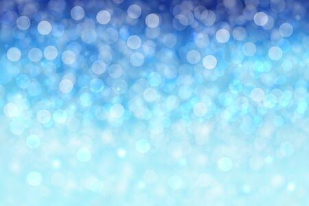 Abstract blurred festive winter christmas or Happy New Year background with shiny blue and white bokeh lighted snow landscape. Space for your design. Card concept. Standard-Bild - 130131470