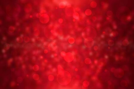 A festive abstract red Happy New Year or Christmas texture background and with color blurred bokeh lights. Space for design. Card concept or advertising.