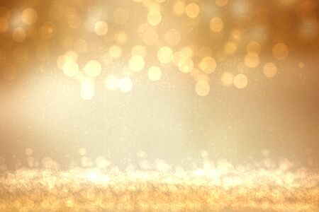 A festive abstract golden yellow gradient background texture with glitter defocused sparkle bokeh circles. Card concept for Happy New Year, party, invitation, valentine or other holidays. Imagens