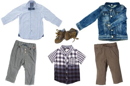 Collage set of children clothes. Two Denim jeans or pants, a pair shoes, a jeans jacket and two blue checkered shirts or t-shirts for child boy isolated on a white background. Concept spring autumn and summer clothes.