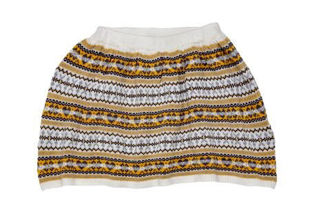 Knitted bright fashionable autumn or winter skirt for little girl with a brown and beige pattern  isolated on white background. Kids autumn and winter fashion. Stock Photo