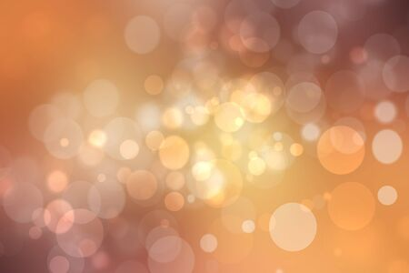 A festive abstract golden yellow pink gradient background texture with glitter defocused sparkle bokeh circles. Card concept for Happy New Year, party invitation, valentine or other holidays.