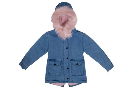 Jeans jacket isolated. A stylish fashionable denim blue child girl jacket with a hood and light pink fur collar and lining isolated on white background. Kids winter fashion.