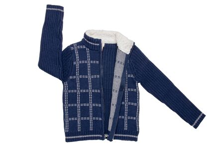 Autumn and winter children clothes. A cozy warm dark blue cardigan or jacket with a white checkered pattern for the little boy isolated on a white background. Kids spring fashion. Stok Fotoğraf