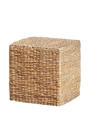 Wicker furniture. Close-up of wicker stool in the form of a cube is also used as a storage next to couches at the hotel swimming pool. Pool accessories. Macro.
