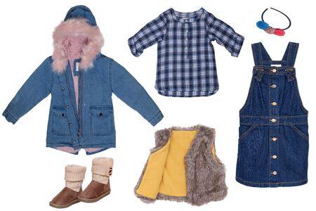 Collage set of little girl autumn clothes isolated on a white background. The collection of a jeans ja cket, a fur vest, a jeans skirt, shirt and boots and other accessories. Kids winter fashion. Banco de Imagens