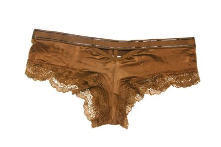 Close-up of luxurious elegant golden brown lacy panties isolated on a white