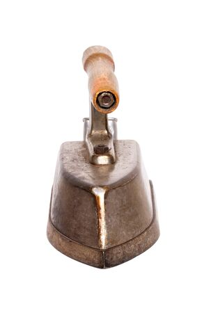 Old iron isolated. Close-up of a professional old large rusty electric tailor iron or flatiron with a wooden handle isolated on a white background. Front view. Banque d'images