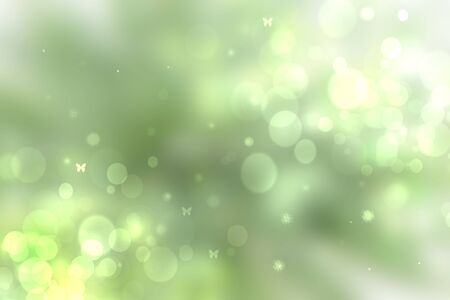 Abstract bright spring or summer landscape texture with natural green bokeh lights and yellow circular lights with sunshine, sun rays and butterflies. Beautiful autumn background with copy space.