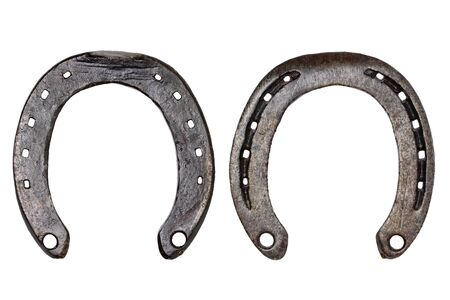 Horseshoe isolated. Close-up of metal horse shoe as a symbol of good luck, prosperity and of a happy future isolated on a white background. Macro photograph. Front and back view.