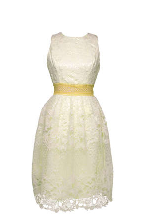 Lacy dress isolated. Closeup of a white yellow stylish sleeveless evening dress with lace on mannequin isolated on a white background. Summer fashion.