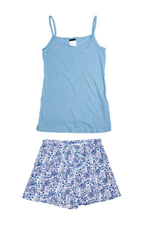 Night gown isolated. Close-up of blue female cotton nightwear summer set of shorts and a top with spaghetty straps isolated on a white background. Fashionable night wear or nighties. Stock Photo